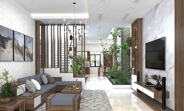 Phòng khách liên thông bếp kết hợp với sự xuất hiện của thiên nhiên giúp ngôi nhà thêm thu hút và ấn tượng